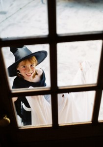View Through a Window of a Girl (8-10) Dressed As a Witch for Trick Or Treat